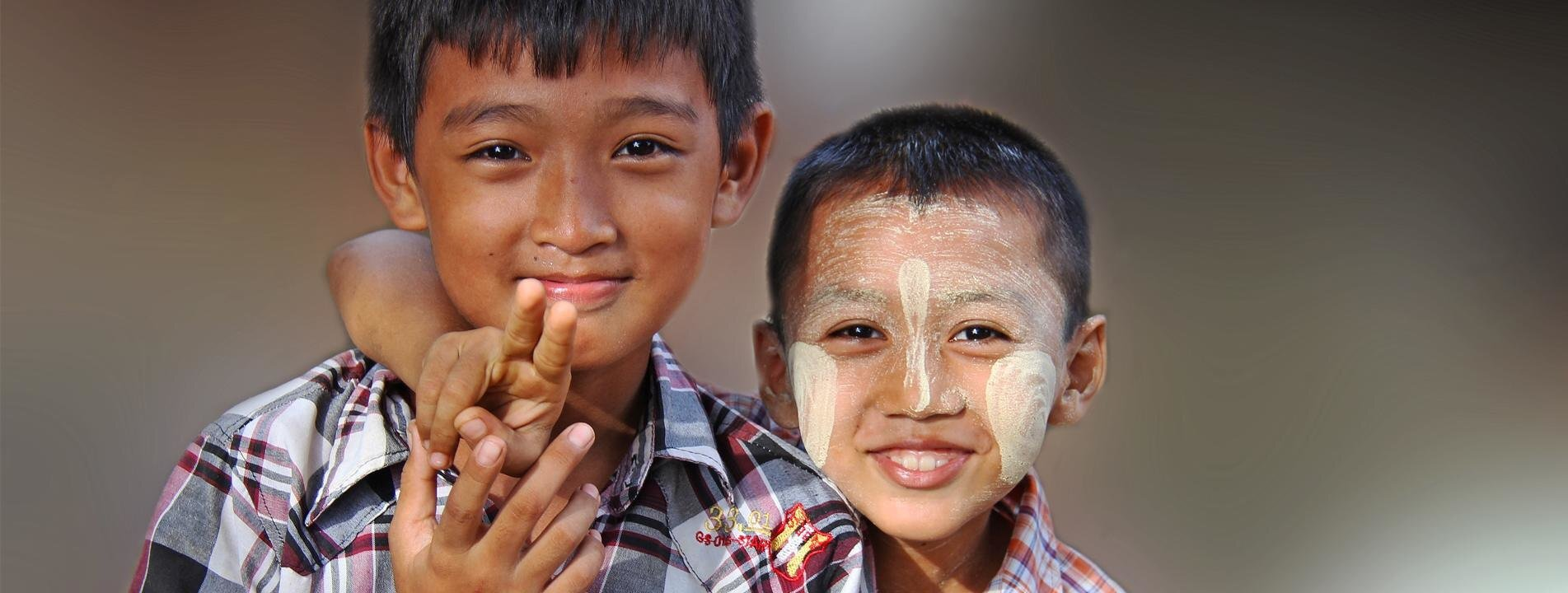 Two Burmese kids welcoming you