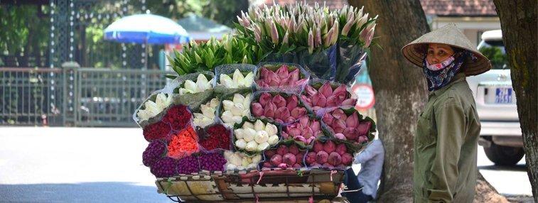 A flower vendor waiting for business