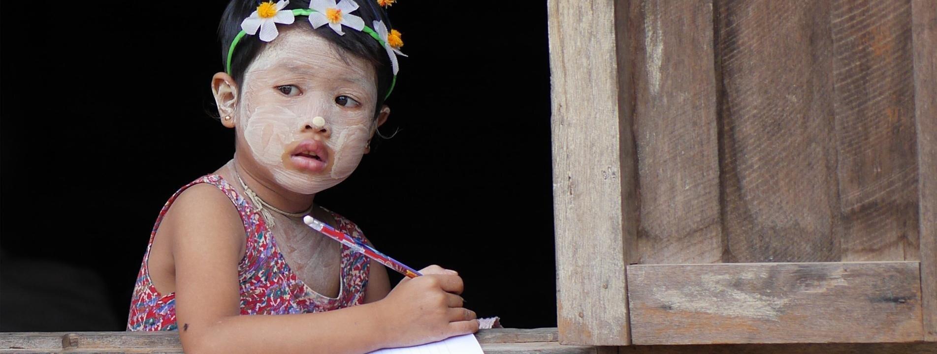 A little Burmese girl by the window