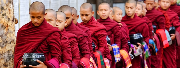 Monks at lunchtime in Bargaya Monastery in Mandalay