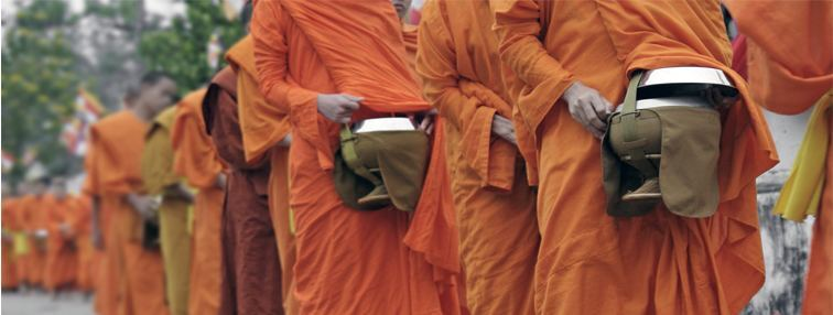 Monks collecting alms in the morning of Luang Prabang