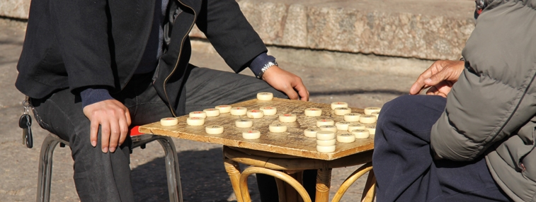 Hutong's daily life: two men playing chess by the street