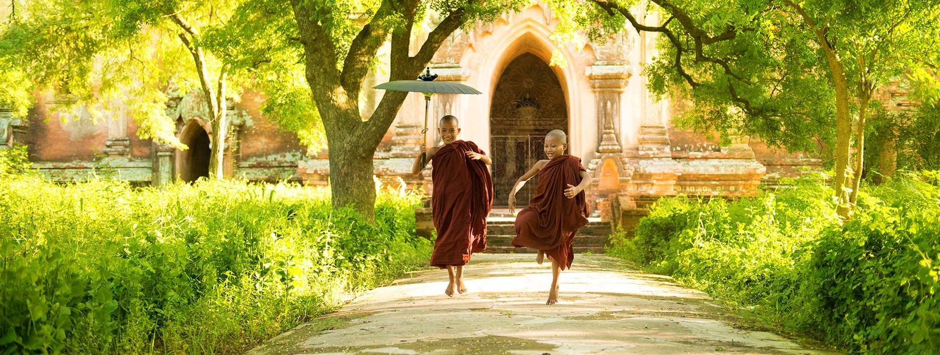 Two novices chasing each other in a monastery in Bagan