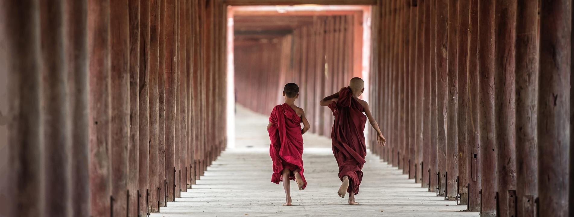 Two novices running at a monastery in Bagan
