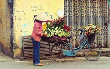 Vietnam Laday Selling Flowers on Bike